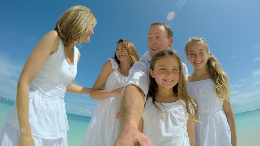 Video selfie of smiling carefree Caucasian family on beach | Shutterstock HD Video #14689579