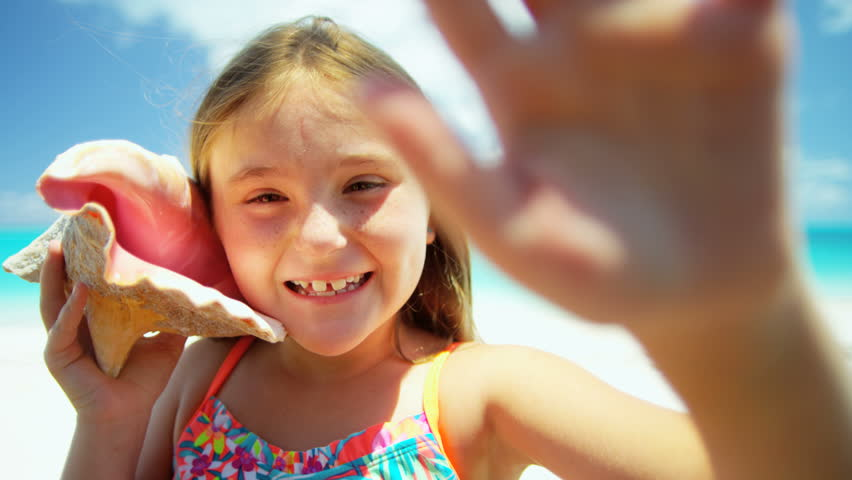 Cute Little Girl Licks Stick From Ice Cream On Beach In Hot Summer Stock Footage Video -5523