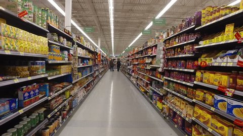 MONTREAL, CANADA - FEBRUARY 2016: Walking through Walmart store - Sauces, oils, pasta, rice, food cans etc.