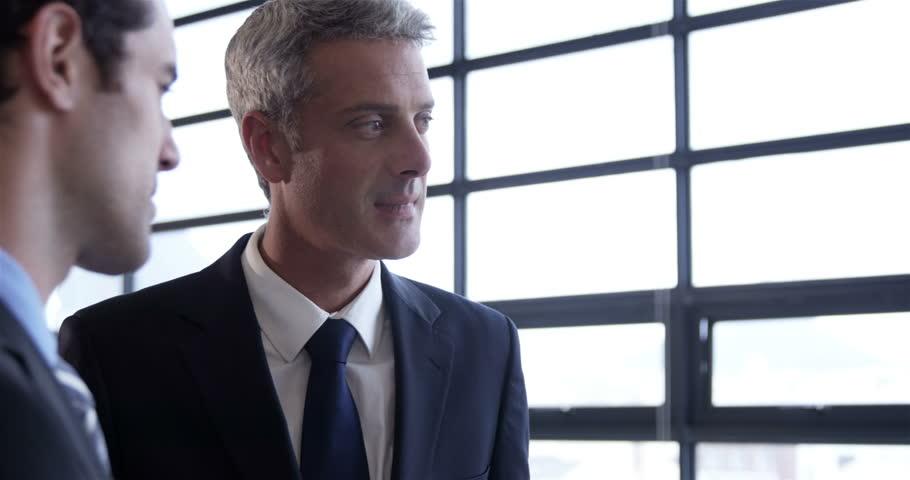 Business people drinking coffee standing in workplace | Shutterstock HD Video #14769382