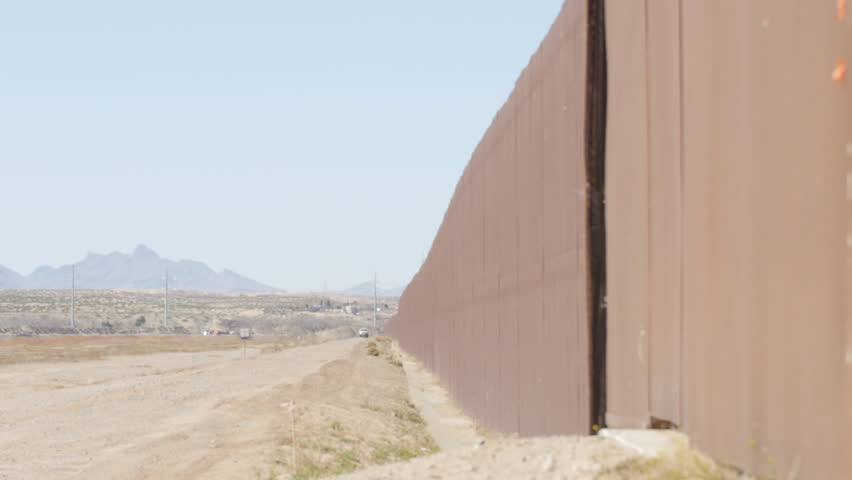 A Pan Shot Looking At The Length Of The Fence On The US And Mexico - Us mexico border map with length