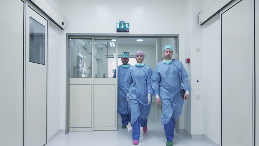 Team of Doctors and Nurses Walking through Hospital. Shot on RED Cinema Camera.