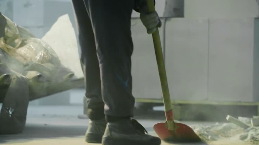close-up of man who clean garbage with a spade in industry  #14792473