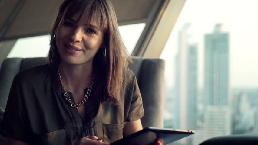 Happy woman with tablet computer talking to camera   | Shutterstock HD Video #14794492
