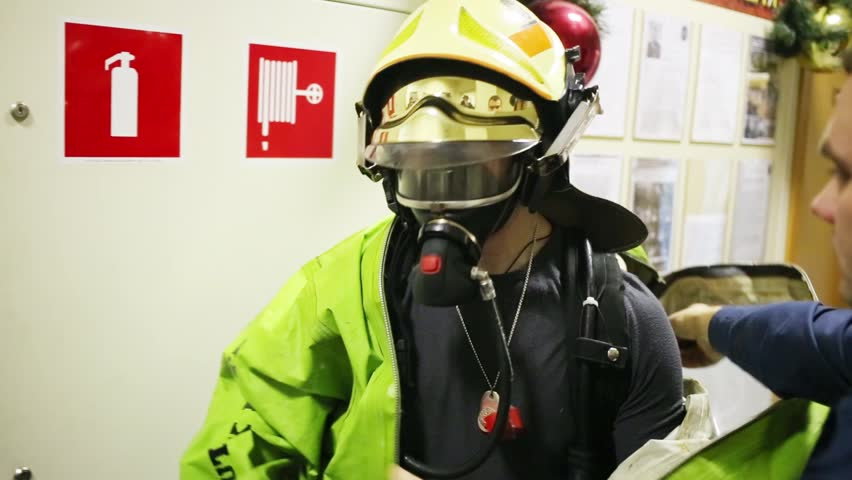 Showing of protective chemical suit with helmet - disrobing