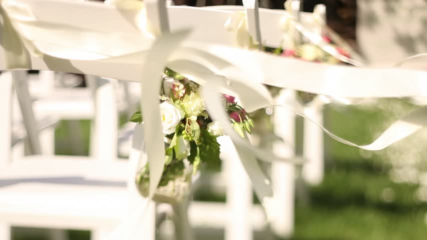 Wedding Decor On The Chairs Ribbons And Flower On White Chairs Roses And Wild