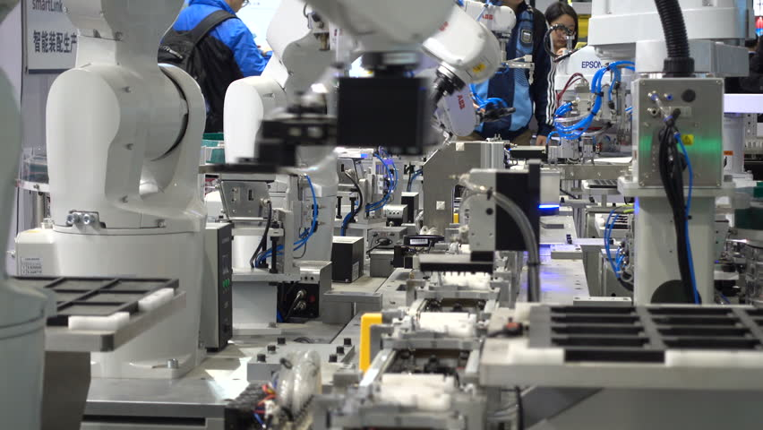 SHANGHAI, CHINA - 7 NOVEMBER 2015: Assembly line robots on display at a robotics and technology fair in Shanghai, China