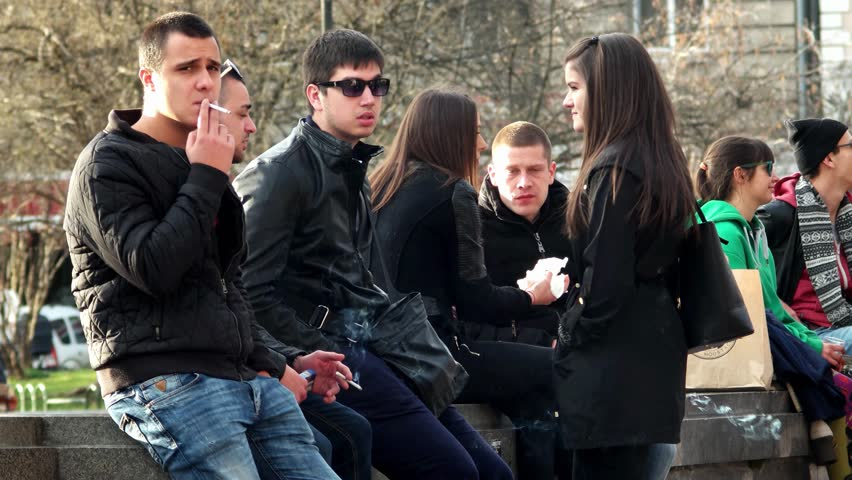 Sofia, Bulgaria - 28 February 2016: group of Young people smoke in park in Sofia, 28 February 2016