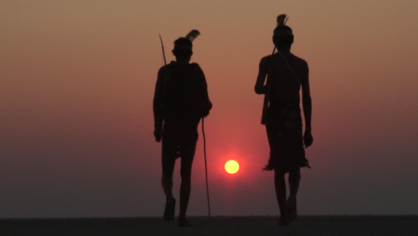 Bushmen walking into the sunset on the Makgadikgadi Pans - Botswana  | Shutterstock HD Video #14903992