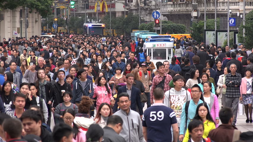 SHANGHAI, CHINA - 31 OCTOBER 2015: Busy crowded shopping street, people walk through the pedestrian only Nanjing Road in Shanghai, China