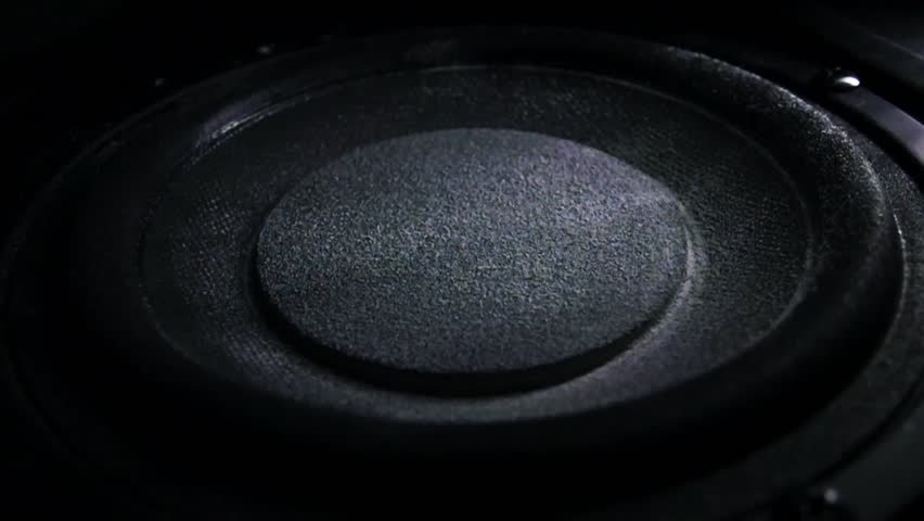 Bass loud speaker throws dust in the air. Super slow motion. Equalizer concept