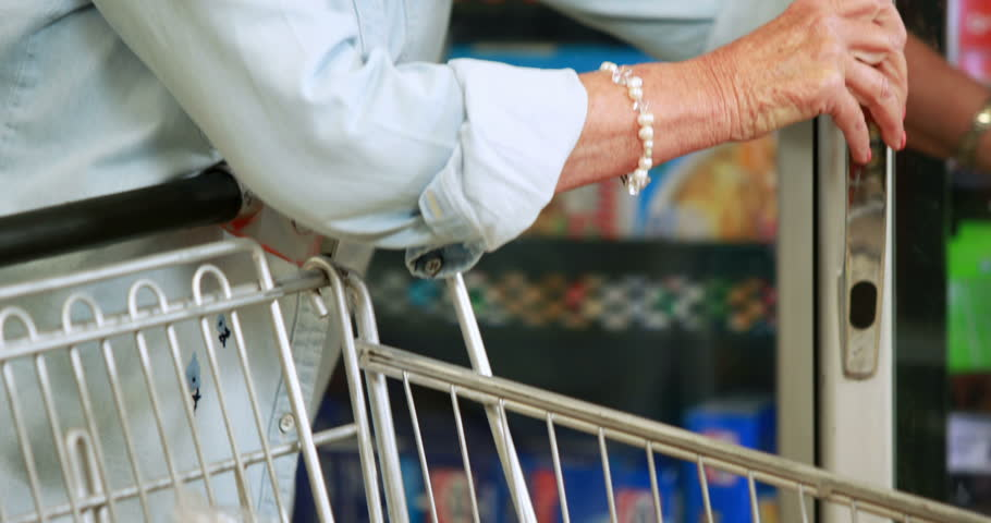 Senior woman shopping in grocery store in high quality 4k format | Shutterstock HD Video #14948722