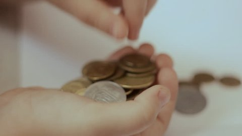 a Small Child is in the Palm Foot Gently Coins to Purchase Saved Money Counting the Household Budget Saving Money in a Piggy Bank Postponement Small Money, Business Training Children