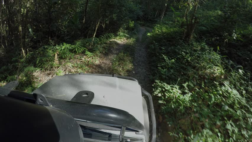 POV 4x4 driving jeep vehicle Wilderness safari mountain forest dirt road Chiangmai Thailand | Shutterstock HD Video #14998129