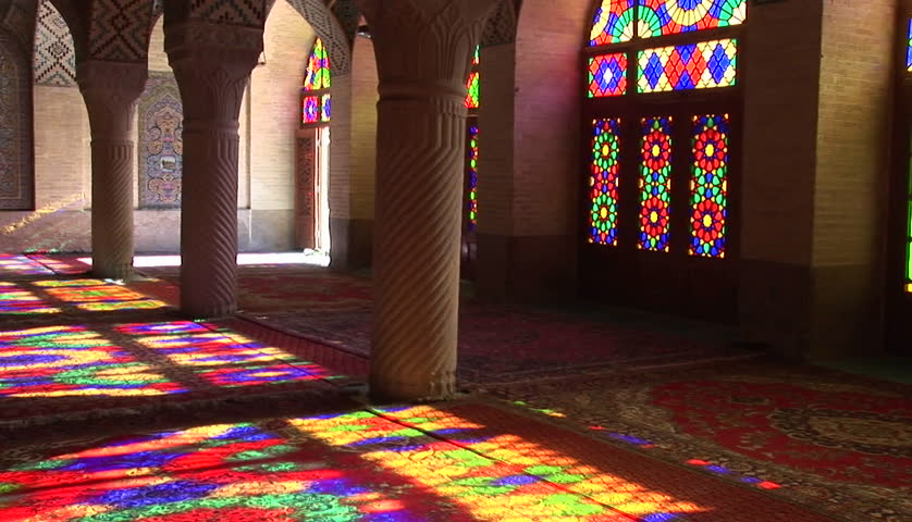 Sun shines through stained glass windows inside the Nasir Molk Mosque in Shriaz, Iran.