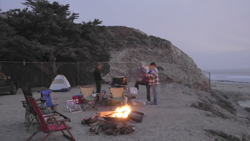 Time lapse of people around a campfire at Jalama Beach County Park, California.