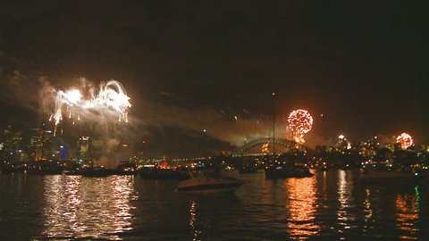 SYDNEY, AUSTRALIA. DECEMBER 31 2012. Sydney New Year's Eve fireworks over the city, slow motion zoom out and with sound 1