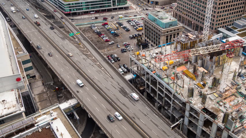 TORONTO - 24 JAN: Timelapse view of a construction site in the center of the city which will be the location of a new condo develoment on 24 January 2014 in Toronto, Canada | Shutterstock HD Video #15018922