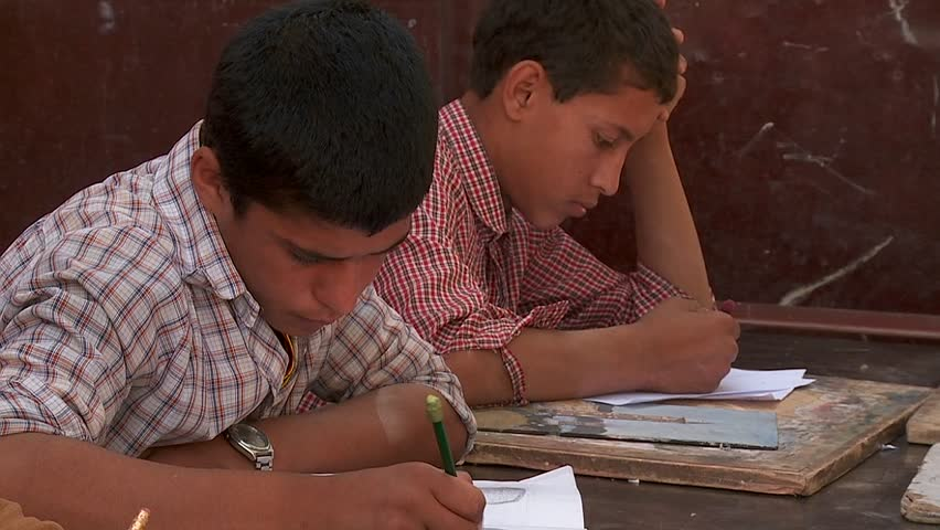 KABUL, AFGHANISTAN - CIRCA 2009: Boys study in a school circa 2009 in Kabul, Afghanistan. Afghanistan is an impoverished and least developed country, one of the world's poorest.
