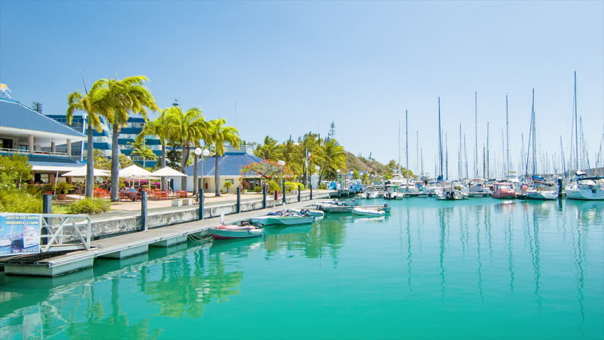 NOUMEA, NEW CALEDONIA - 2016: Port Moselle Marina Waterfront with Restaurants Facing Turquoise Sea Water Filled with Recreational Boats and Yachts