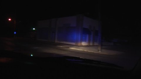 Police car code 3 POV at night