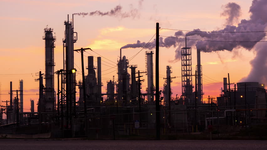 HOUSTON - 12 FEB: Timelapse view of a refinery silhouetted against the sunset at dusk on 12 Feb 2015 in Houston, Texas, USA