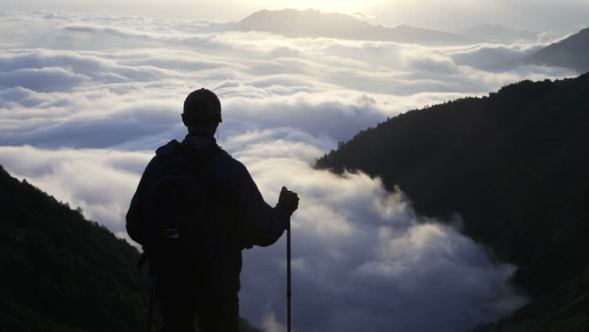 The traveler, mountains and clouds | Shutterstock HD Video #1507487