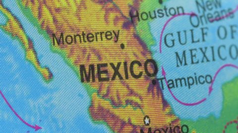 Terrestrial globe smoothly rotates and stops at the map of Mexico
