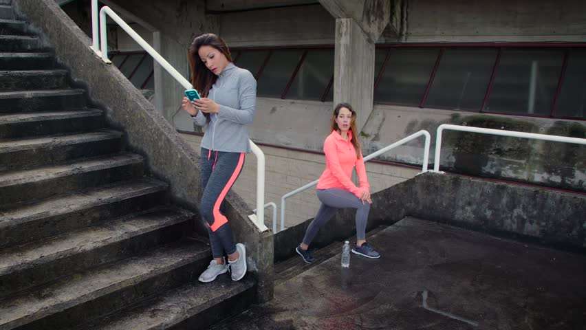 Fitness Women Working Out Doing Lunges On City Stairs Outdoor Urban Workout Concept Female Athletes Training Together Stock Footage 15111202