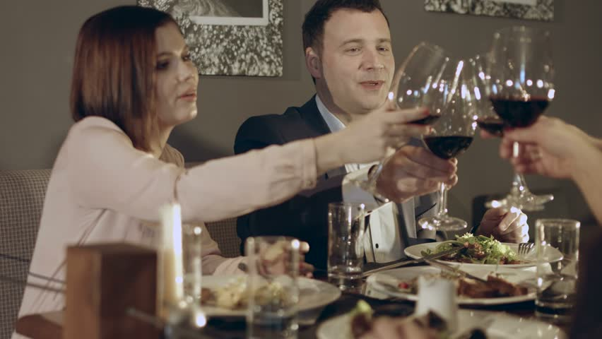 Friends say a toast during a dinner    Shutterstock HD Video #15112942