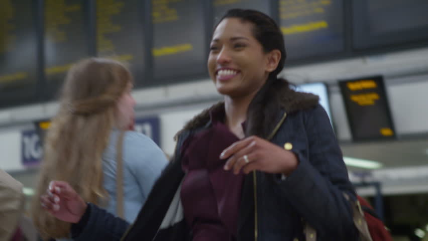 4k, attractive woman rushes to greet her boyfriend at the train station