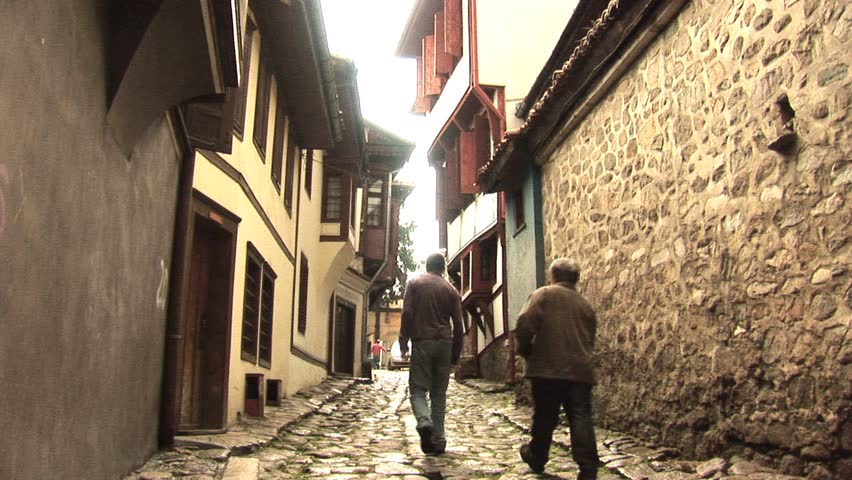 Two people walking on a cobble stone street circa 2010 in Plovdiv, Bulgaria