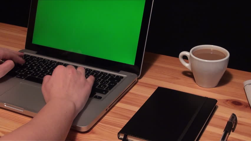 Woman hands typing on a laptop with green screen chroma on a wooden table. Woman typing on the keyboard of a silver laptop-Adrian | Shutterstock HD Video #15234202
