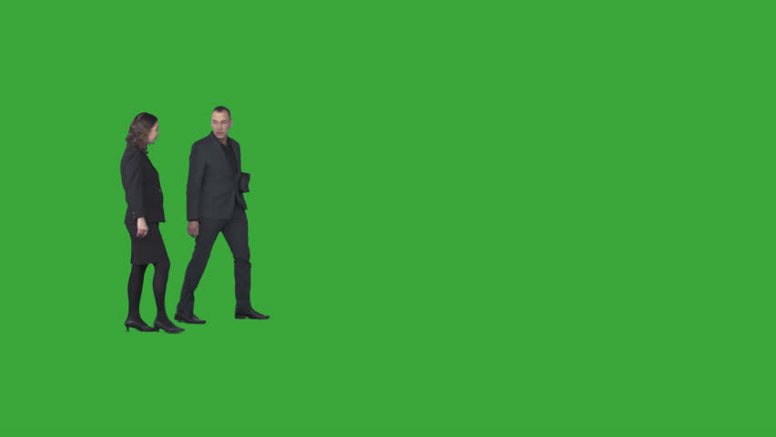 Smart business man in dark suit & his coworker woman in business clothes walk & discuss. Cut out on transparent background. File format - .mov, codec PNG+Alpha. Shutter angle -180 (native motion blur)