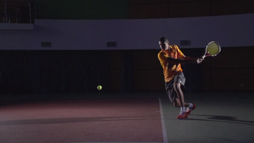 Backhand stroke in tennis. Spectacular shot in slow motion. Professional lighting