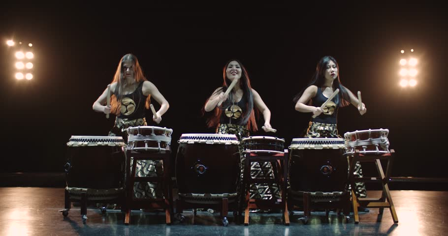 very epic performance of three Japanese Taiko drummer on stage, with sound,various rhythm
