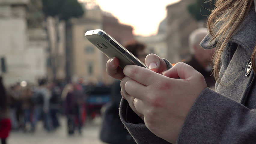Close-Up Shot Of Woman's Hands Using mobile phone In Busy Public Place | Shutterstock HD Video #15281269