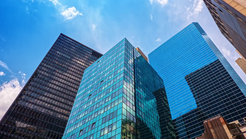 Skyscrapers blue sky reflection glass facades corporate buildings Manhattan New York City NYC | Shutterstock HD Video #15302362