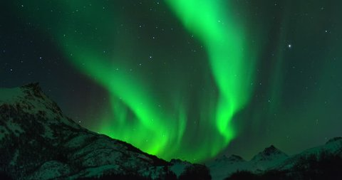 Time lapse clip of Polar Light or Northern Light (Aurora Borealis) in the night sky over the Lofoten islands in Norway in winter.