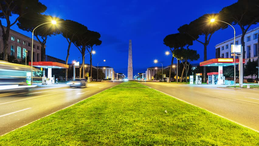 Time Lapse of the traffic at night in EUR district with view over Marconi obelisk. Rome, Italy