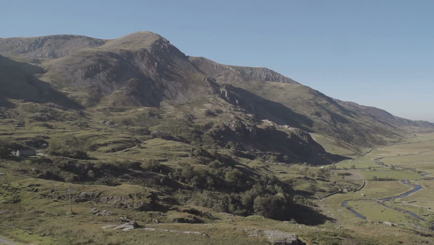 Snowdonia Ogwen Valley North Wales. A shot of a mountain range in Snowdonia, North Wales. Filmed on a perfect sunny day in Summer time in the United Kingdom.