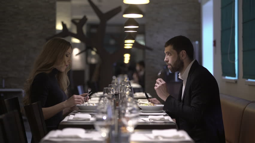 Couple in a restaurant is eating salad   Shutterstock HD Video #15319672