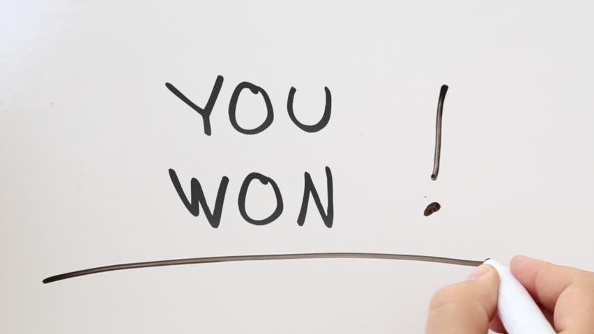 Shot of You won written on whiteboard