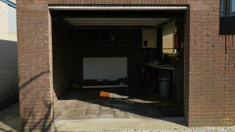 Garage door of a detached house closing