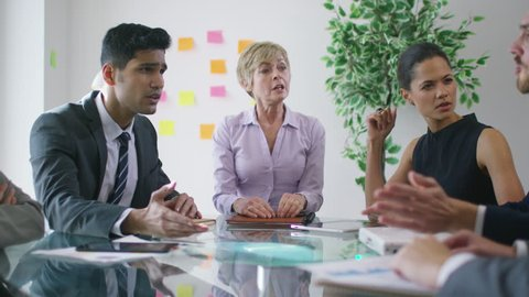 4K Stress in the workplace - corporate business team argue over poor performance