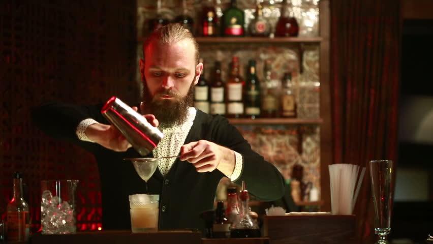 Handsome barman professional at posh bar making cocktail drinks #15359710