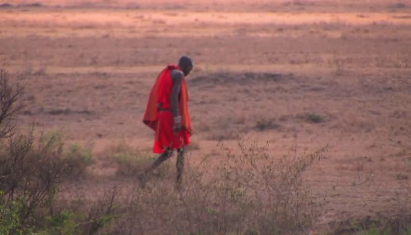KENYA, AFRICA - CIRCA 2009: A tribesman walks across savannah circa 2009 in Kenya.