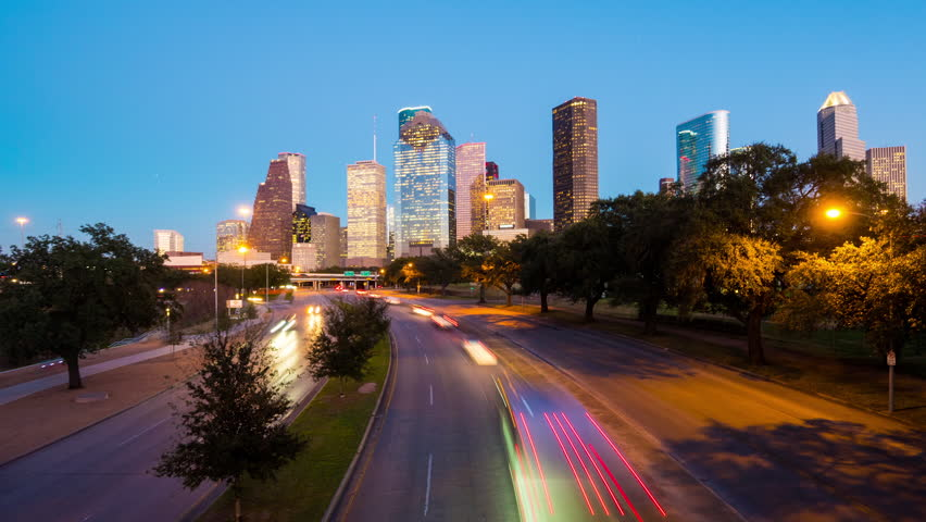 HOUSTON - 14 FEB: Zoom in timelapse view of the Houston City skyline at dusk with traffic moving at night, on 14 Feb 2015 in Houston, Texas, USA