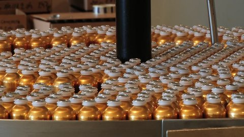 GRASSE, FRANCE - APRIL 10, 2014: Perfume bottles move by the transportation line at the Fragonard perfume factory in Grasse, France.