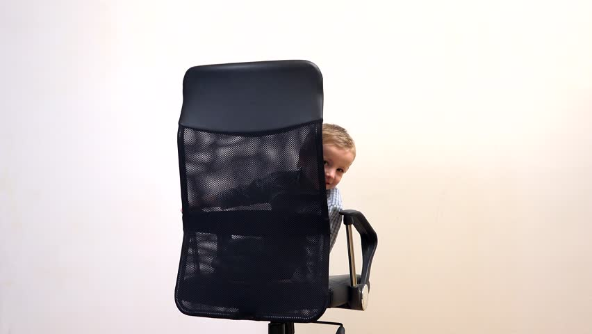 cute childs office chair. little businessman in office chair child plays hide and seek the 4k cute childs a